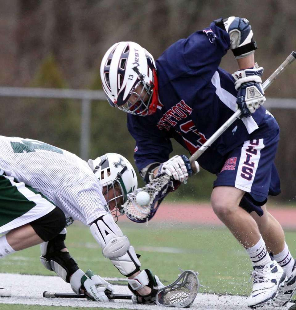 Smithtown West's Craig Madarasz comes away with ball
