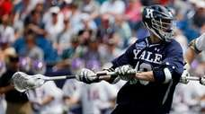Yale's Jack Tigh works against Albany during the
