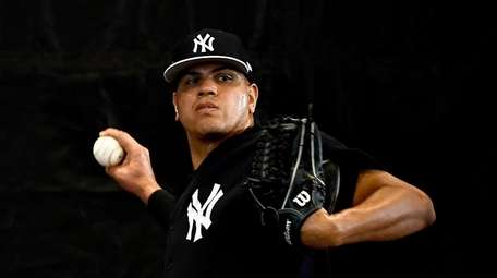 Dellin Betances throws a bullpen session during spring