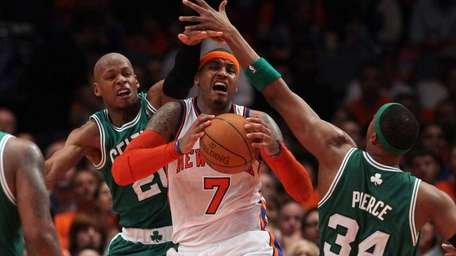 Carmelo Anthony battles for the ball against Ray