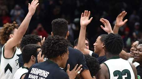 Brentwood celebrates after their 57-54 win over Uniondale