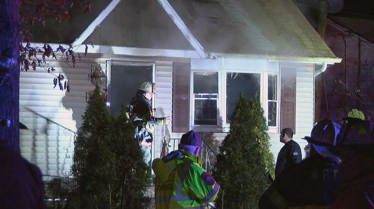 Firefighters at the house fire on Sinn Street
