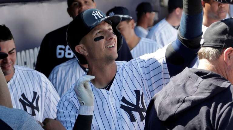 The Yankees' Troy Tulowitzki celebrates in the dugout