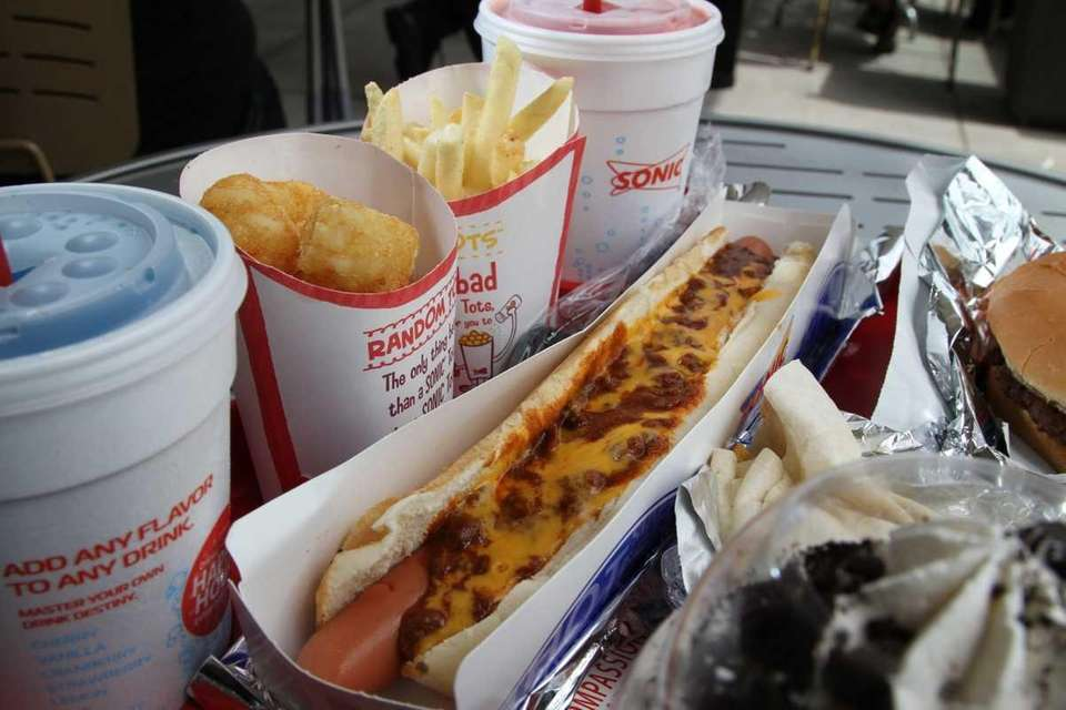 An order with a chili cheese hot dog,