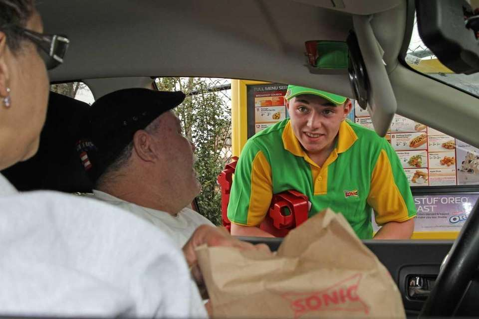 Joe Cleator, right, from Sonic, delivers an order