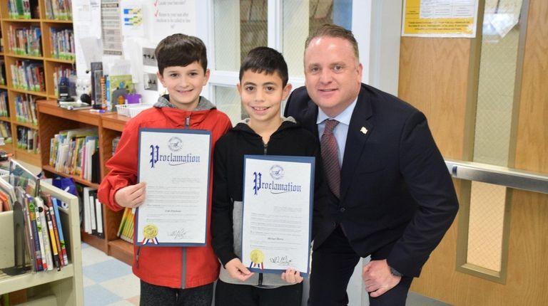 Grundy Avenue Elementary School fifth-graders Cole Friedman, left,