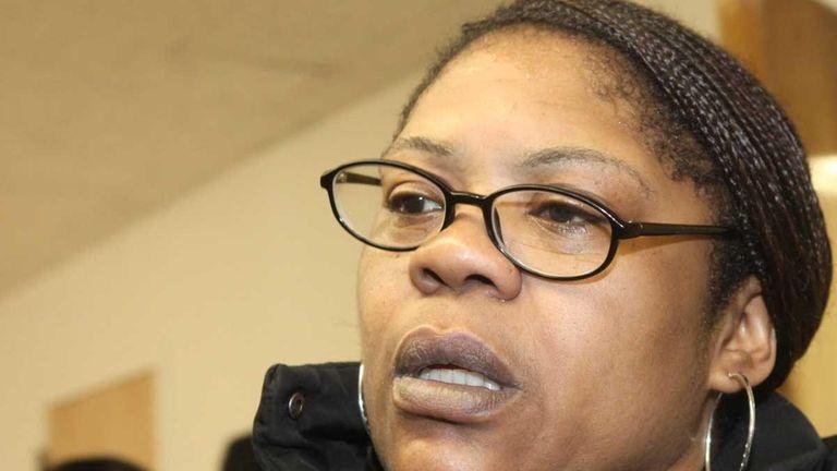 Diane McCloud, 47, leaves Mineola court. (April 25,