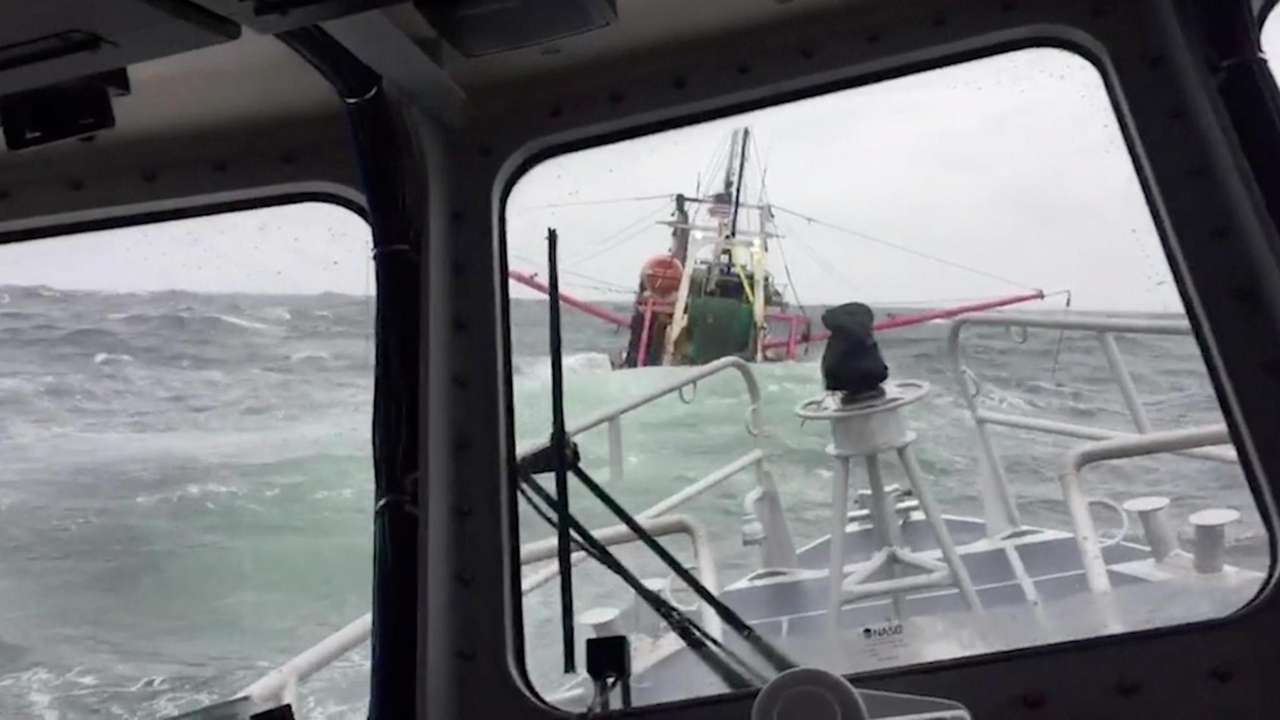 Two men were rescued Sunday from a sinking
