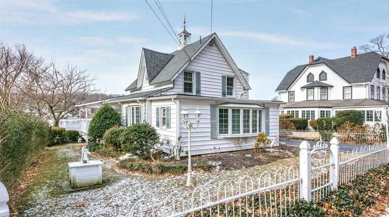 This 1860 Centerport home features waterfront views.