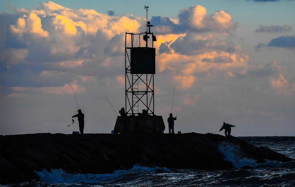 Fisherman gather at dusk to test their skills