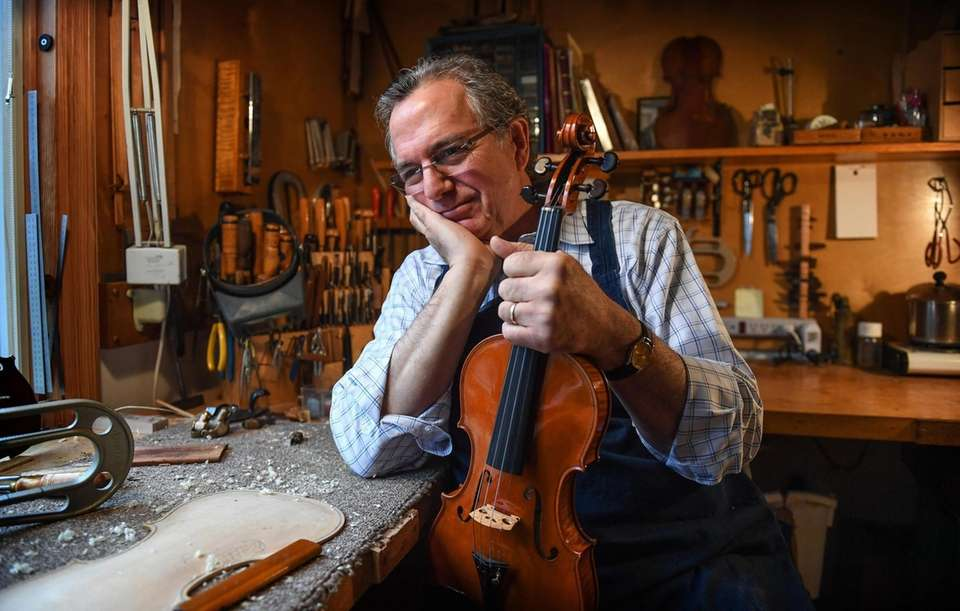 Portrait of master violin maker Charles Rufino, 66,