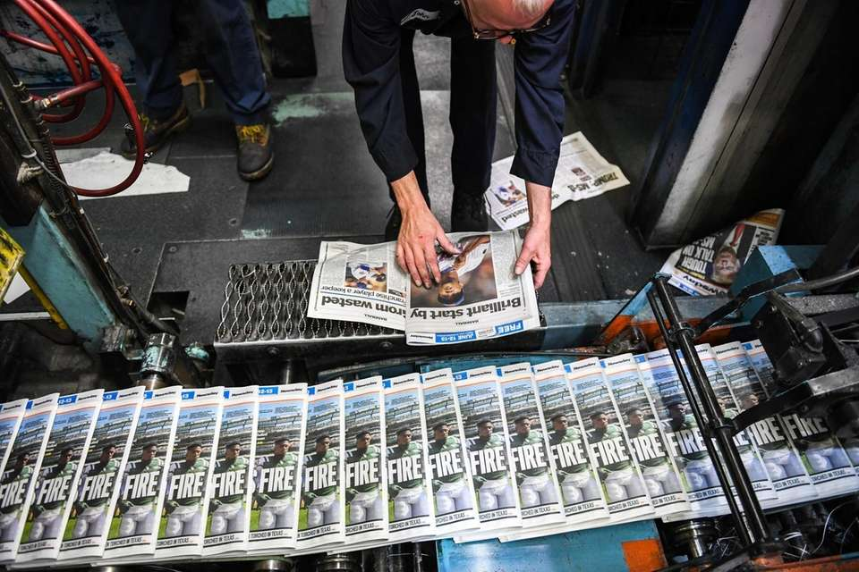 A press operator checks copy inside the pressroom