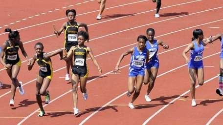 Relay teams from Uniondale, Copiague and Hempstead pass