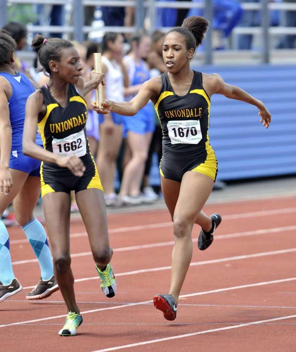 Brittney Webley, right, passes the baton to Uniondale