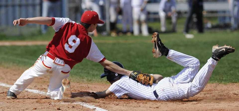 West Babylon's James Nunns is safe at first