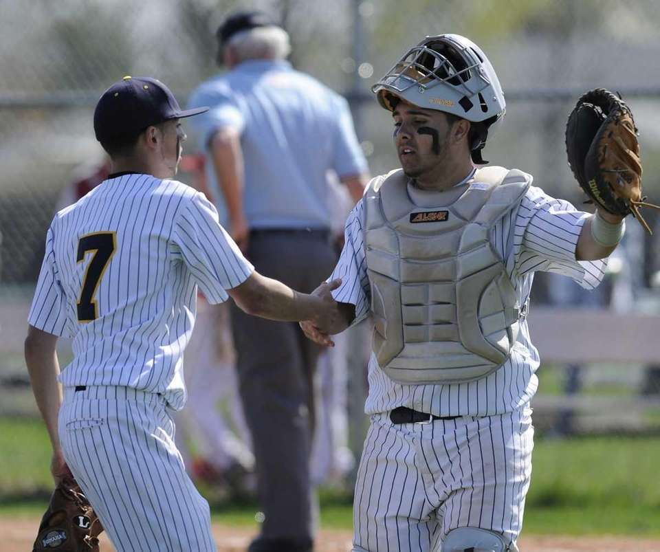 West Babylon catcher Dominick Penna, right, congratulates pitcher