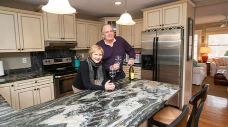Joan and John Fitzsimons in the kitchen of