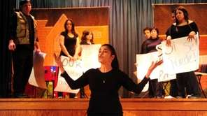 Margarita Espada, center, of Teatro Experimental Yerbabruja performs