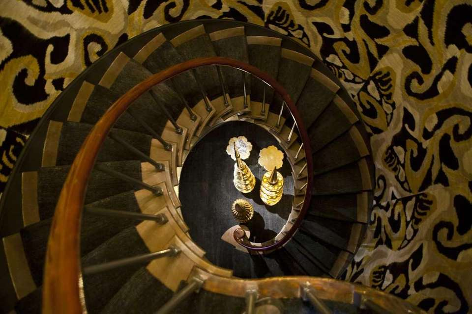 Rauber + Rauber Interiors designed this stairwell in