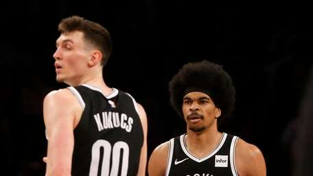 Jarrett Allen #31 and Rodions Kurucs #00 of