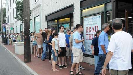 People wait on line at Book Revue in