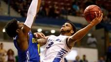 Hofstra's Justin Wright-Foreman, at right, drives to the