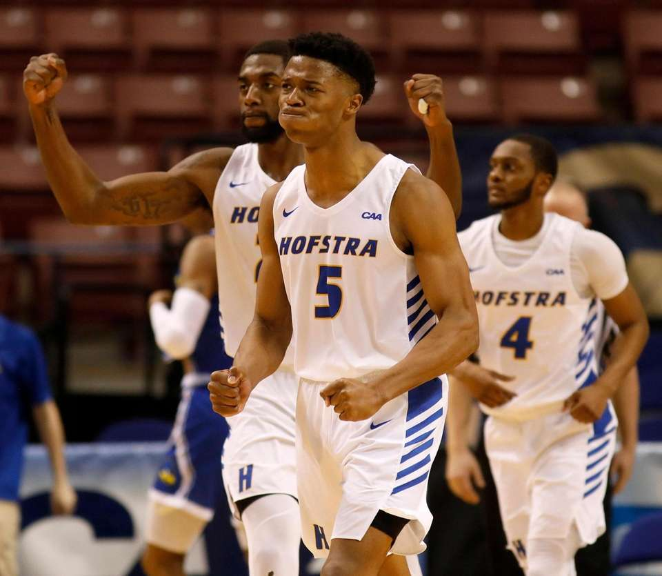 Hofstra's Eli Pemberton (5) celebrates with Jacquil Taylor,