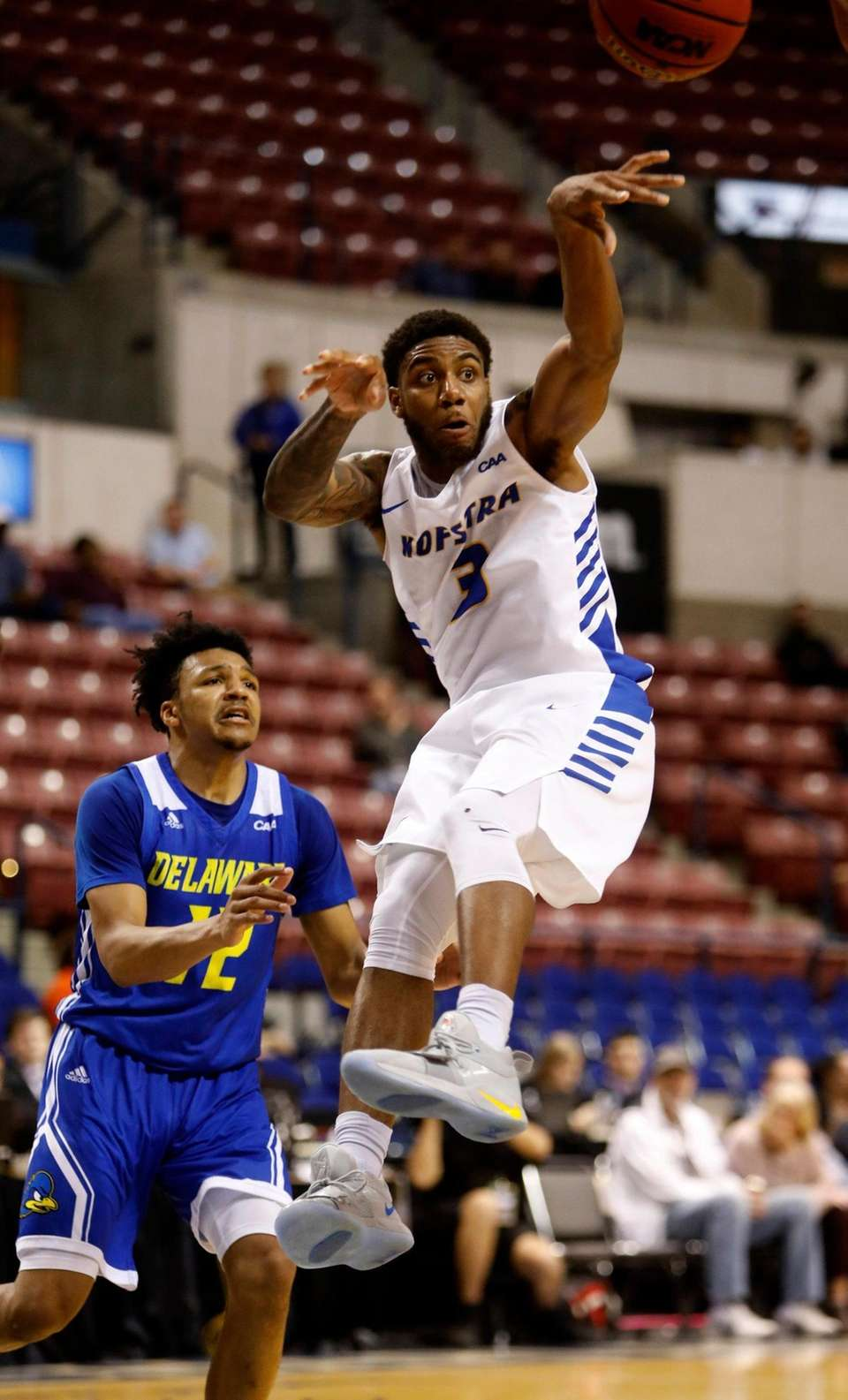Hofstra's Justin Wright-Foreman passes the ball to the