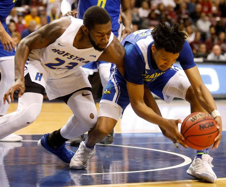 Hofstra's Jacquil Taylor, at left, goes for a