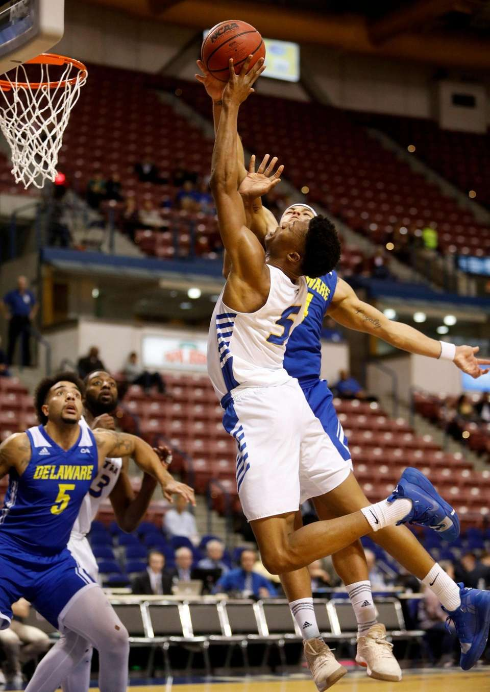 Hofstra's Eli Pemberton (5) goes up for a
