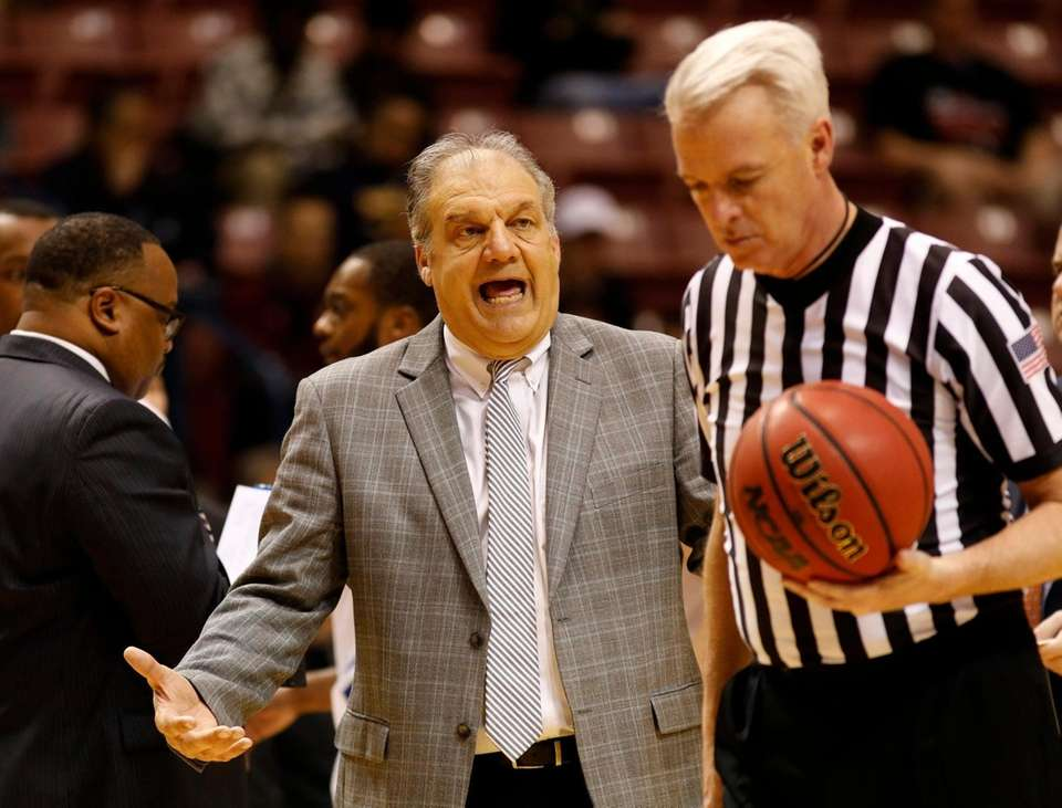 Hofstra's head coach Joe Mihalich talks to a