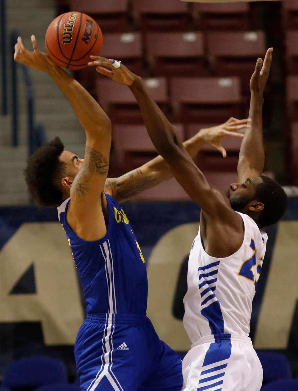 Hofstra's Jacquil Taylor, at right, blocks the shot