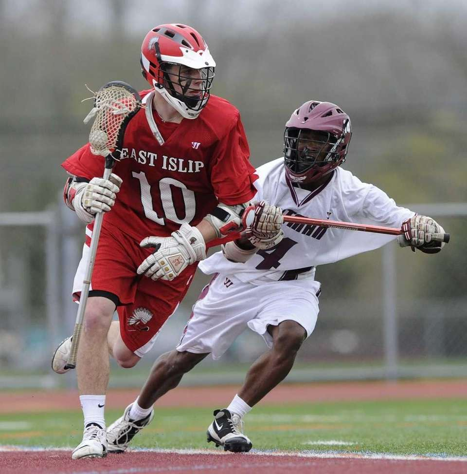 East Islip midfielder Kevin Hutchinson gets pressured by