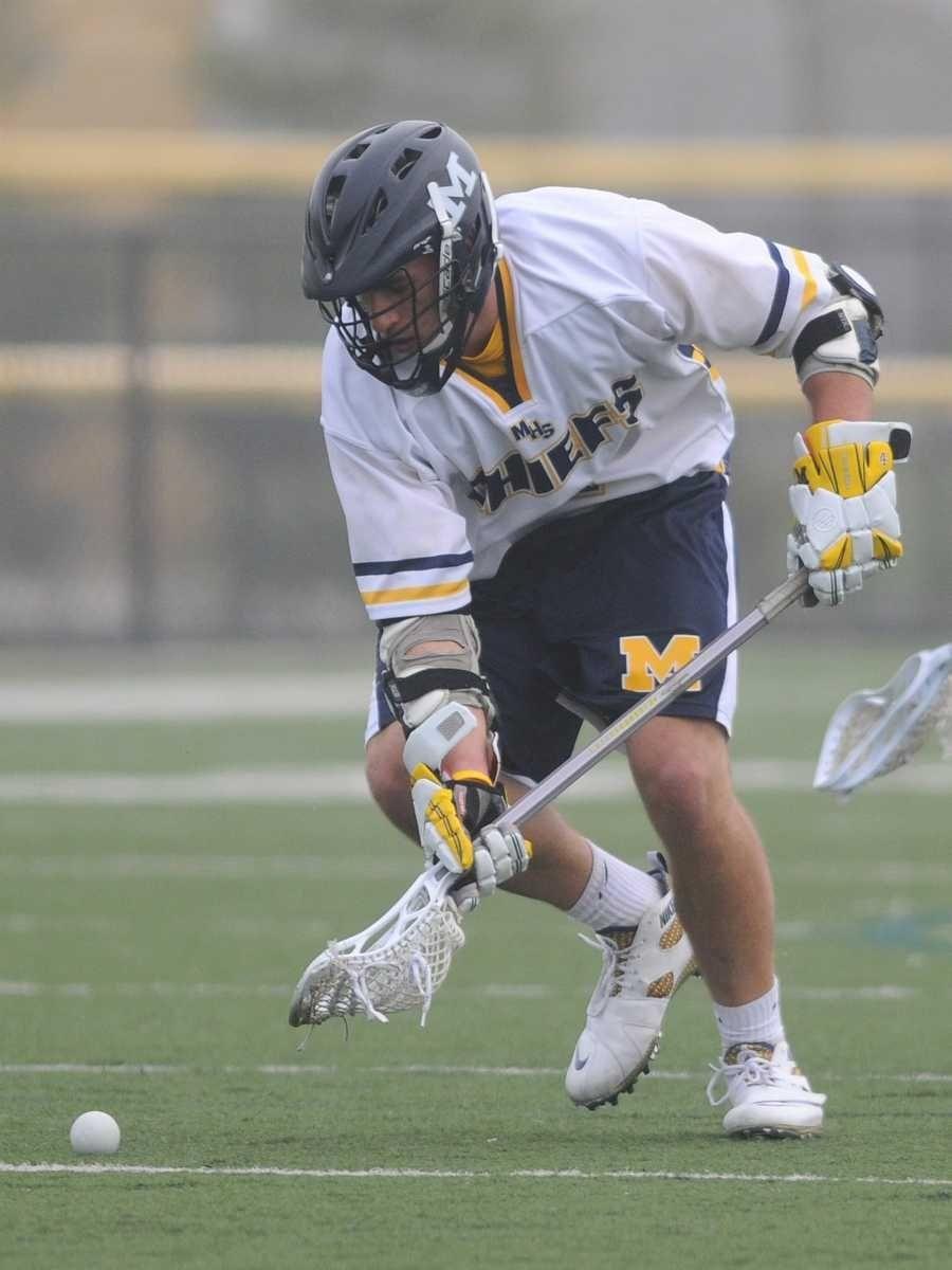 Massapequa High School #4 Steven Romano scoops up