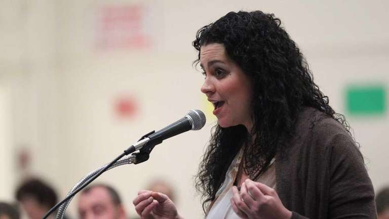 Jennifer Scully speaks during a school board meeting.