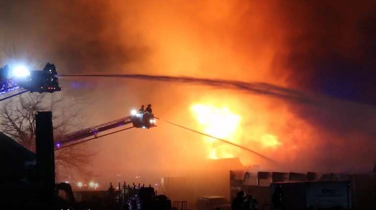 Firefighters at Cove Plumbing Supply Co. Inc. on