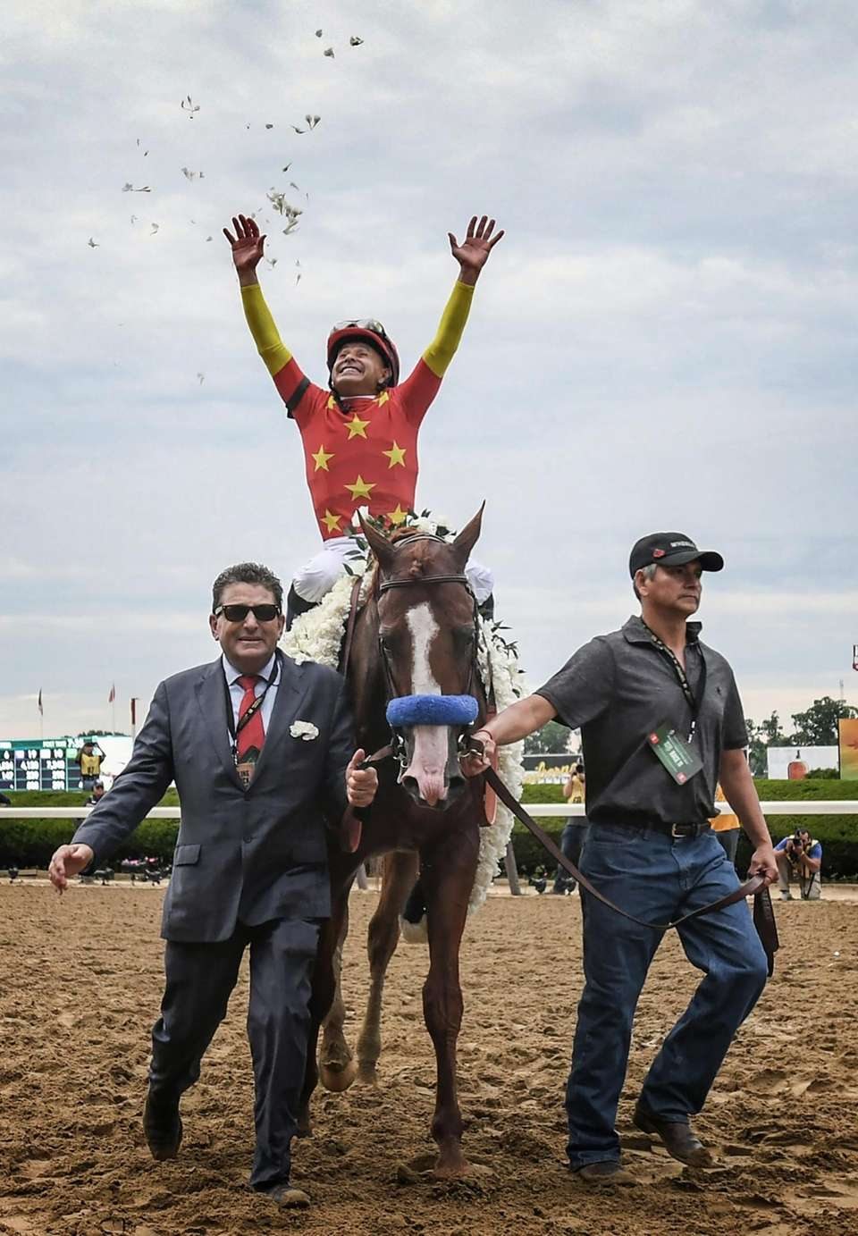 Jockey Mike Smith throws rose petals in the