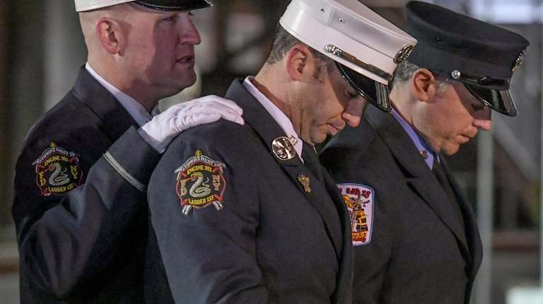 FDNY Captain Daniel Kudlak, center, who worked with