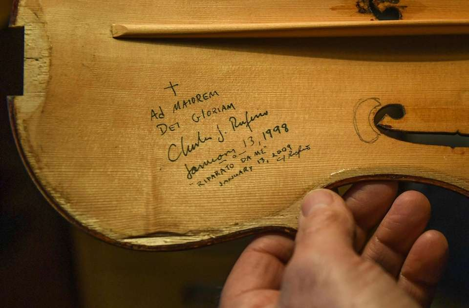 Charles Rufino signs and dates his instruments, writing