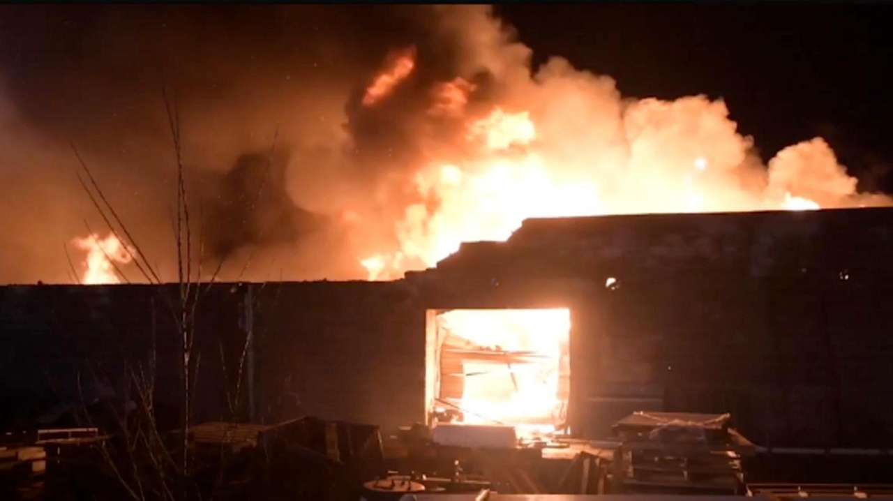 Firefighters from multiple departments battled a large structure