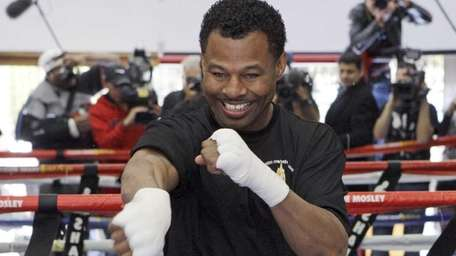 Shane Mosley shadow-boxes during a workout in front
