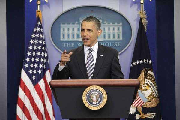 President Barack Obama gestures while speaking to reporters