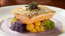 Pan-seared Arctic char rests on a bed of