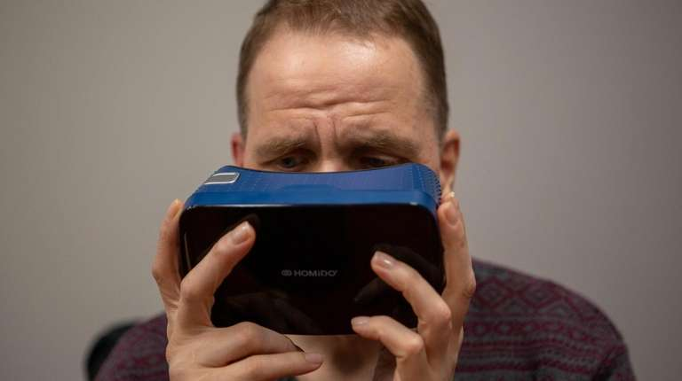 Mark Hemple uses Google Expeditions virtual-reality headset at