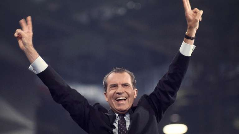 Richard Nixon waves to delegates and spectators after