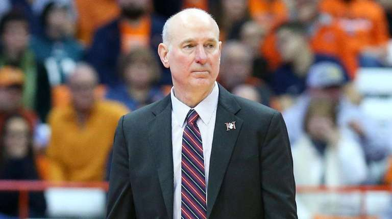 Northeastern head coach Bill Coen looks on against
