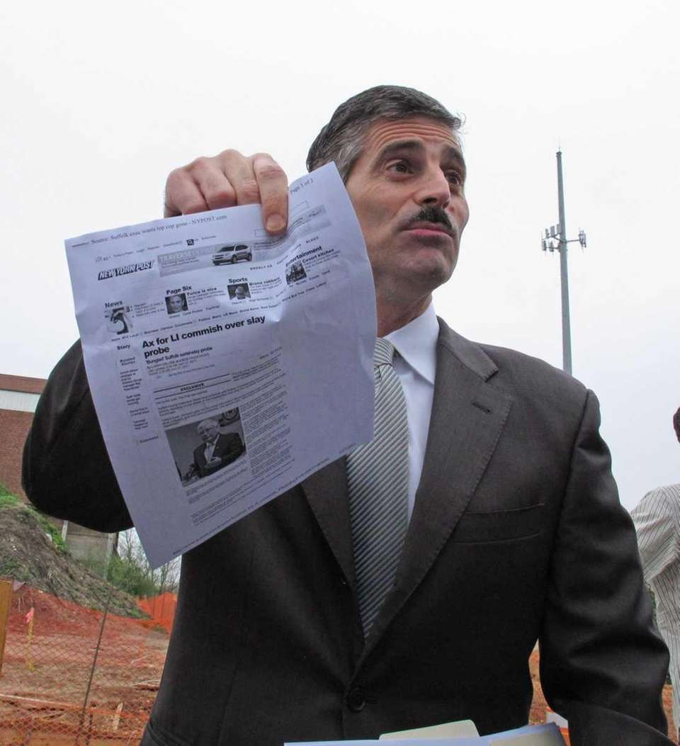 Suffolk County Executive Steve Levy holds up a