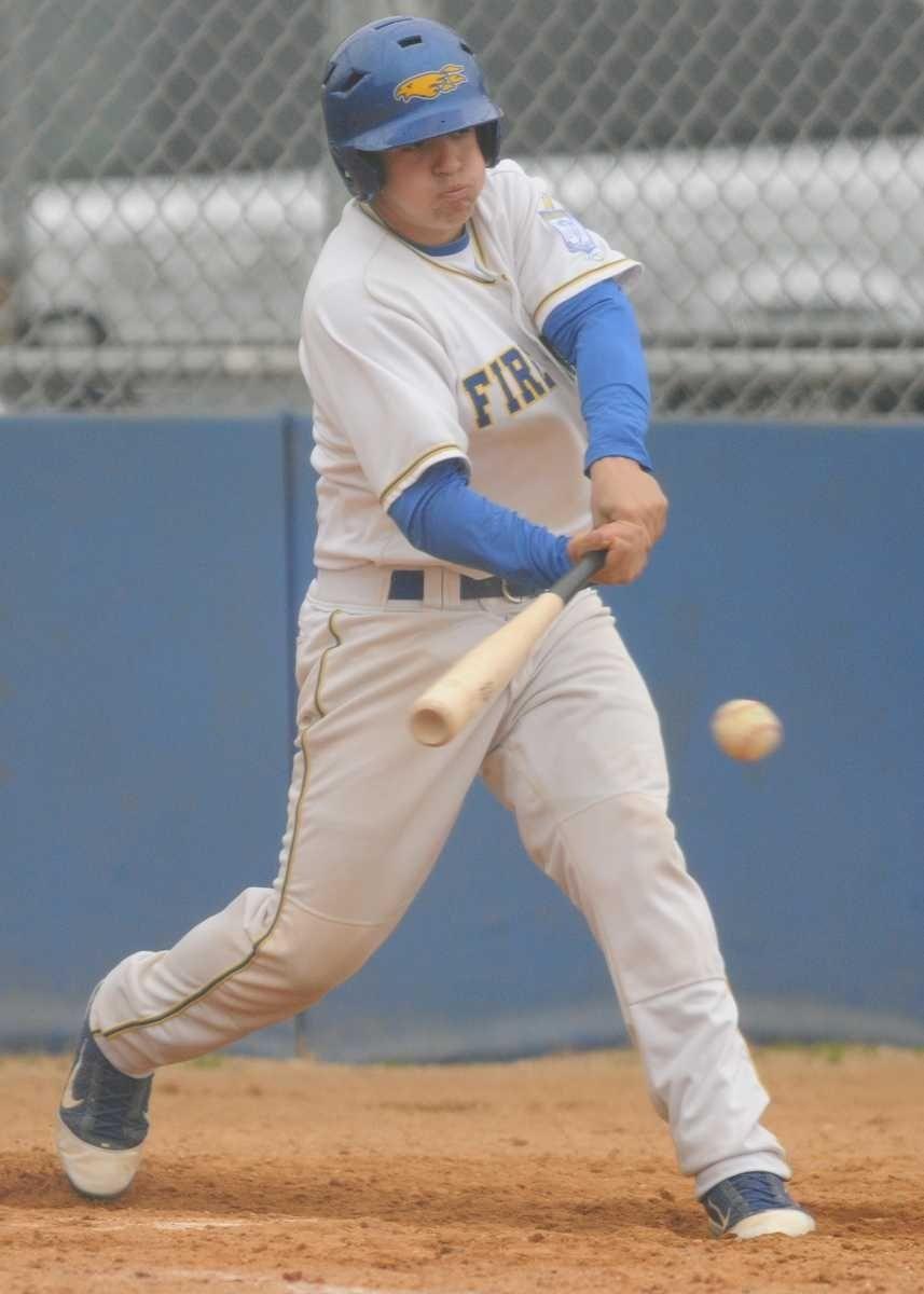 Kellenberg High School catcher #8 Niko Costalas hits