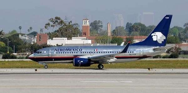 An AeroMexico Boeing 737-700 waits on the runway