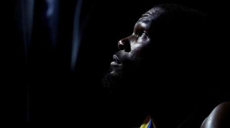 Golden State Warriors' Kevin Durant looks up as